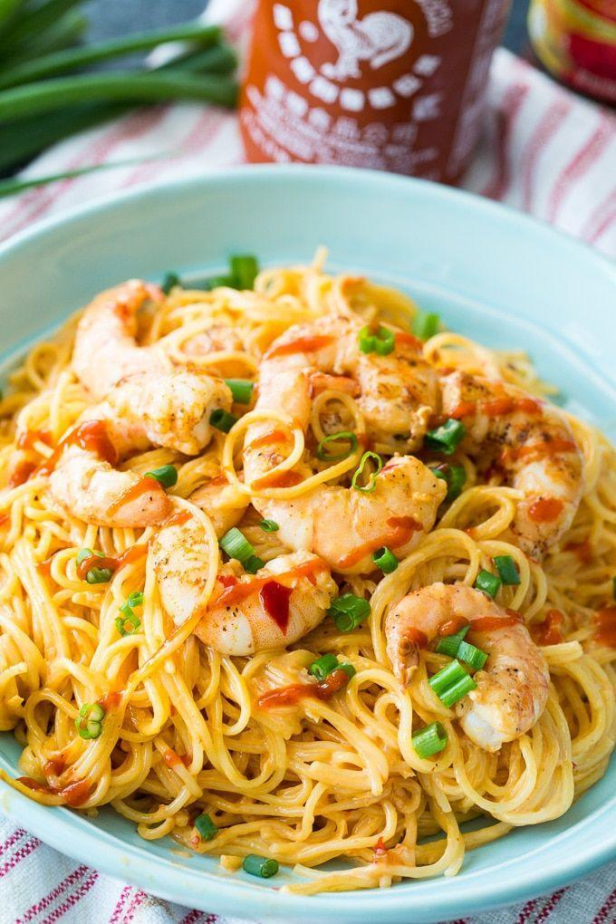 """<p>Spicy, sweet, savory—this dish has it all! The mayo, sweet chili, and Sriracha-tossed shrimp make this plate of pasta irresistible.</p><p><strong>Get the recipe at <a href=""""https://spicysouthernkitchen.com/bang-bang-shrimp-pasta/"""" rel=""""nofollow noopener"""" target=""""_blank"""" data-ylk=""""slk:Spicy Southern Kitchen"""" class=""""link rapid-noclick-resp"""">Spicy Southern Kitchen</a>.</strong></p><p><strong><a class=""""link rapid-noclick-resp"""" href=""""https://www.amazon.com/Stainless-Steel-Skillet-Glass-Cover/dp/B01D0MDZRO/ref=sr_1_5?tag=syn-yahoo-20&ascsubtag=%5Bartid%7C10050.g.1487%5Bsrc%7Cyahoo-us"""" rel=""""nofollow noopener"""" target=""""_blank"""" data-ylk=""""slk:SHOP SKILLETS"""">SHOP SKILLETS</a></strong> </p>"""