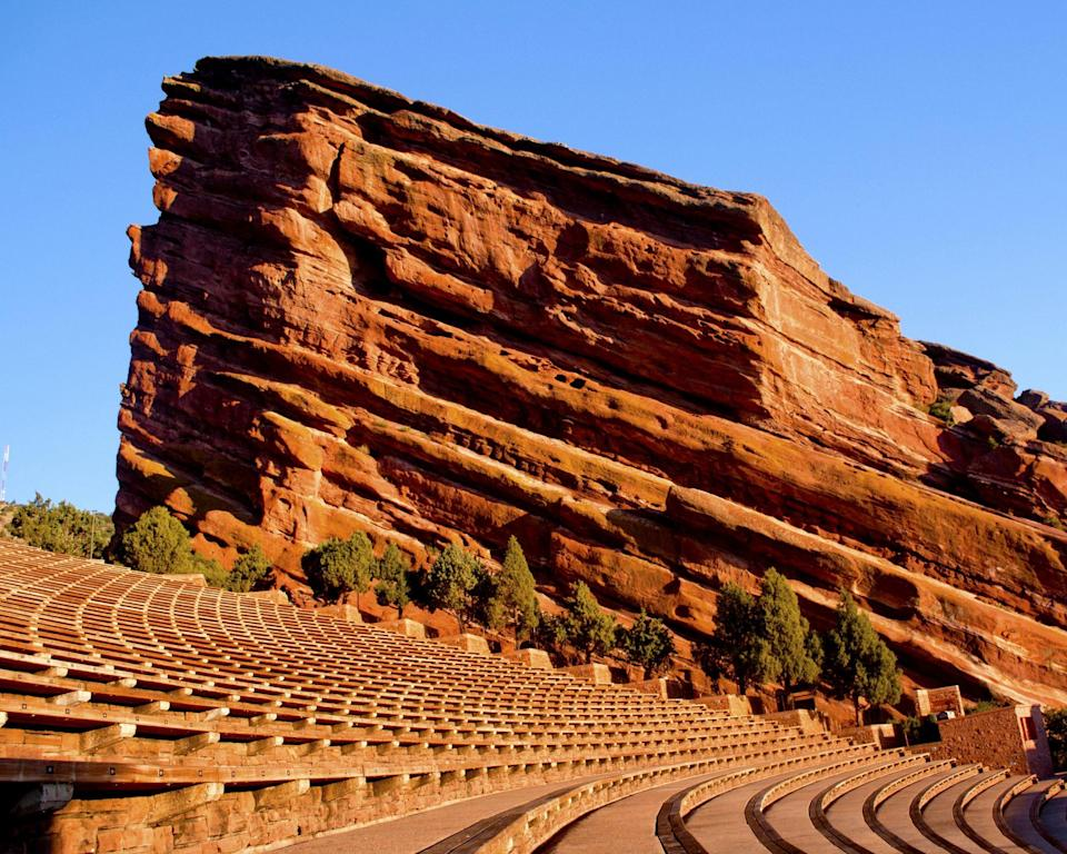 """<p><span><strong>Red Rocks Amphitheater</strong>:</span> In Morrison, Colo., the bright-red sandstone monoliths that jut out from either side of the stage create one of the few acoustically perfect natural amphitheaters in the world (see image). </p> <p><a href=""""https://www.hollywoodbowl.com/"""" rel=""""nofollow noopener"""" target=""""_blank"""" data-ylk=""""slk:Hollywood Bowl:"""" class=""""link rapid-noclick-resp""""><strong>Hollywood Bowl:</strong> </a>The stunning performance space built under the Hollywood Hills has hosted everyone from the Beatles to Aretha Franklin. This year stars like Christina Aguilera and H.E.R. will perform under the iconic band shell.</p> <p><strong><a href=""""https://www.tanglewood.org/Performance/Listing?brands=6427&searchKeywords=Boston%20Symphony%20Orchestra"""" rel=""""nofollow noopener"""" target=""""_blank"""" data-ylk=""""slk:Tanglewood"""" class=""""link rapid-noclick-resp"""">Tanglewood</a>:</strong> Lawn seats are the way to go at this Lenox, Mass., gem tucked inside the Berkshire Hills. Pack blankets and a picnic to hear the Boston Symphony Orchestra or Boston Pops perform here in the summer. </p> <p><a href=""""https://www.jaypritzkerpavilion.com/"""" rel=""""nofollow noopener"""" target=""""_blank"""" data-ylk=""""slk:Jay Pritzker Pavilion:"""" class=""""link rapid-noclick-resp""""><strong>Jay Pritzker Pavilion:</strong></a> Designed by architect Frank Gehry in Chicago's Millennium Park, the stage is crowned with crisscrossing steel ribbons and pipes that stretch over the Great Lawn.</p>"""