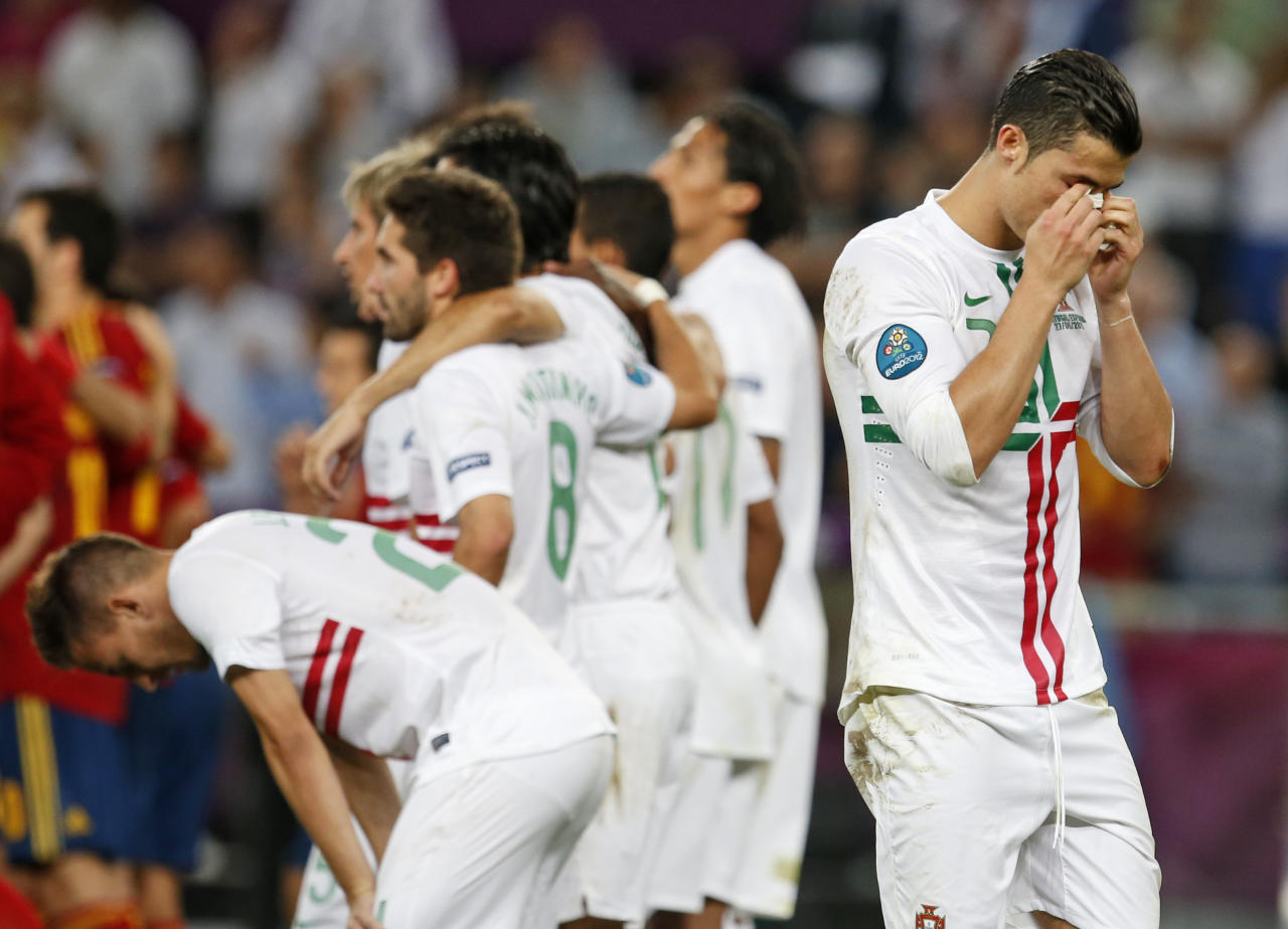 Portugal's Cristiano Ronaldo, right, reacts during the penalty shootout at the Euro 2012 soccer championship semifinal match between Spain and Portugal in Donetsk, Ukraine, Thursday, June 28, 2012. (AP Photo/Armando Franca)