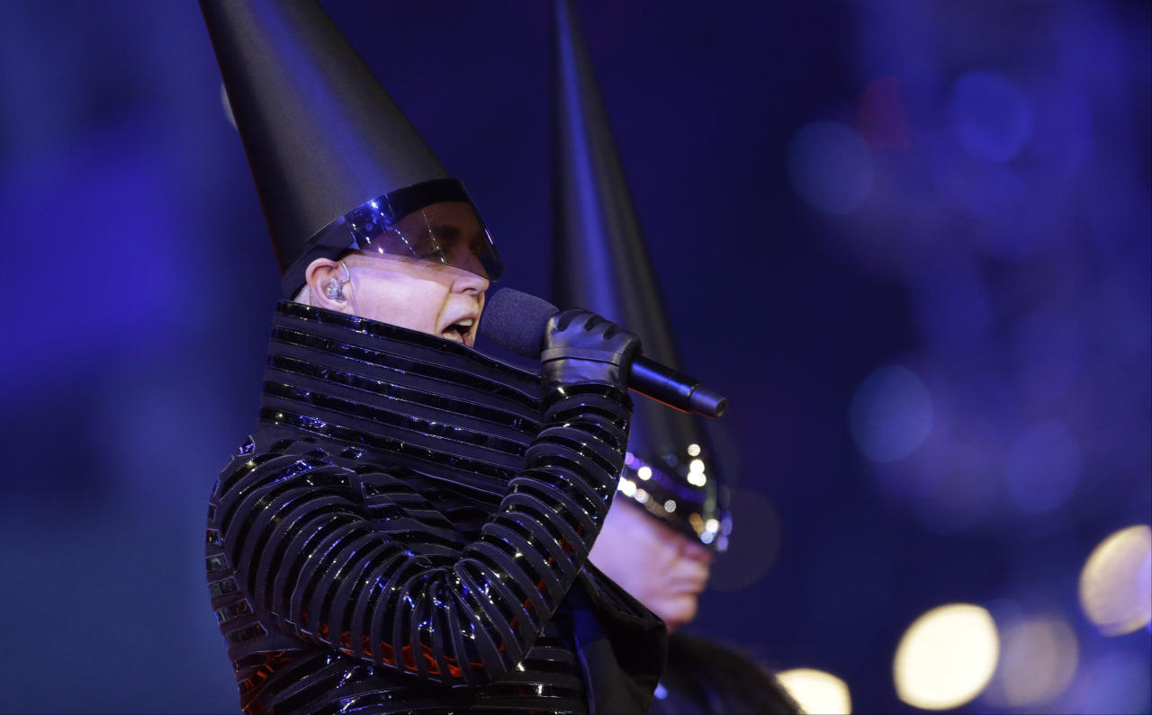 NOW: Neil Tennant, singer of the Pet Shop Boys, performs during the Closing Ceremony at the 2012 Summer Olympics, Sunday, Aug. 12, 2012, in London. (AP Photo/Patrick Semansky)