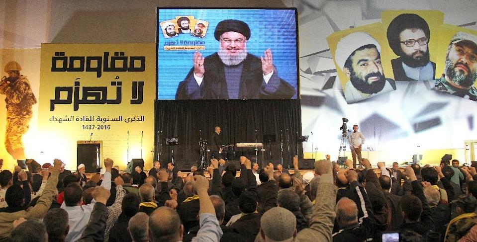 "Hezbollah chief Hassan Nasrallah, seen on screen as he addresses the crowd in Beirut on February 16, 2016, said Turkey and Saudi Arabia ""are not ready to accept a political solution"" in Syria (AFP Photo/Anwar Amro)"
