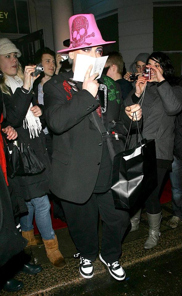 "Boy George tried to hide from the paparazzi while exiting Sony's soiree held at the Aubrey Restaurant and Bar, but who could miss the ""Karma Chameleon"" singer in that bedazzled hot pink hat? <a href=""http://www.infdaily.com"" target=""new"">INFDaily.com</a> - February 16, 2010."