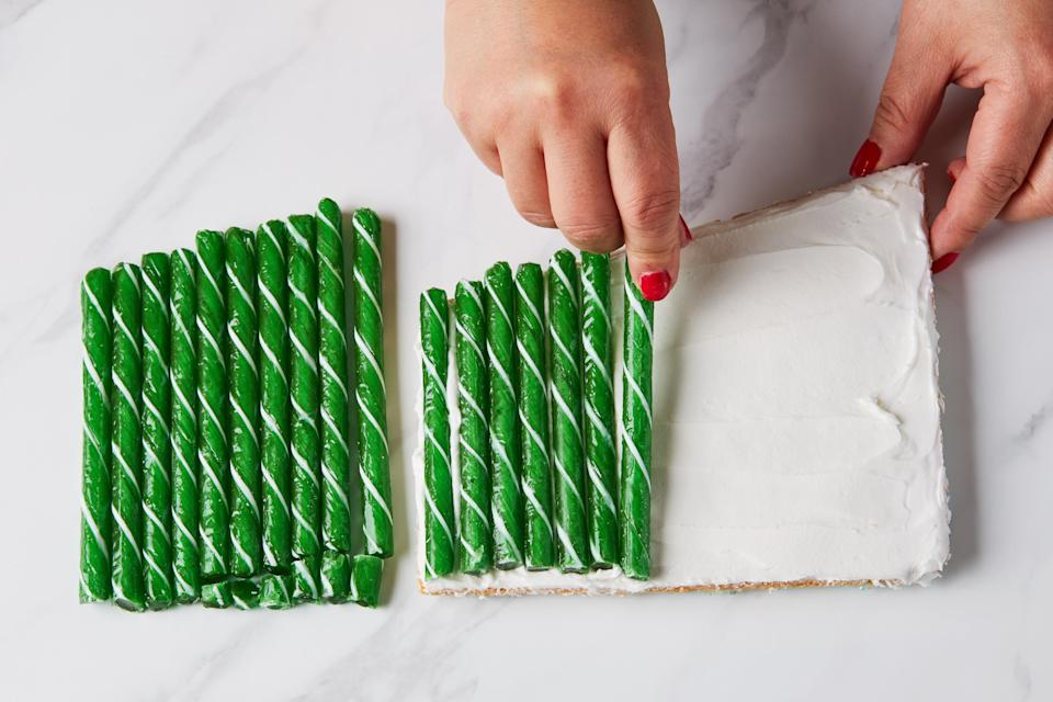 Photo B: Candy sticks are lined up like little soldiers during installation on wall W2.