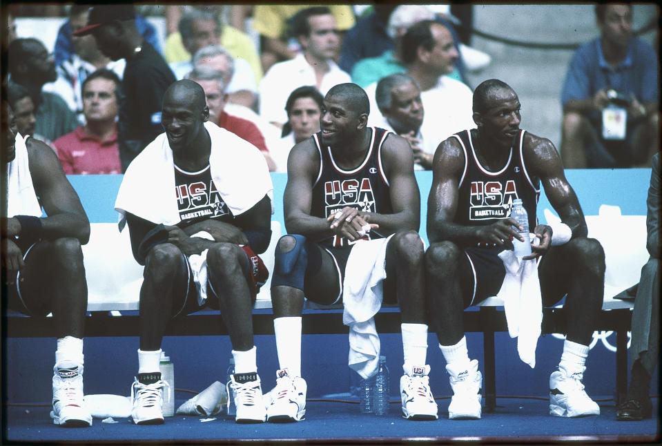 1992:  Michael Jordan (L), Magic Johnson (M) and Clyde Drexler (R) of Team USA, the Dream Team, sit on the bench during the men's basketball competition at the 1992 Summer Olympics in Barcelona, Spain. (Photo by Icon Sportswire)