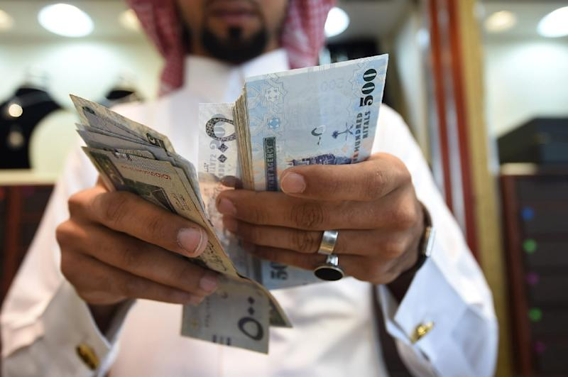 Saudi Arabia plans to raise up to $17.5 billion from its first international bond issue, as analysts expect strong buyer interest (AFP Photo/Fayez Nureldine)