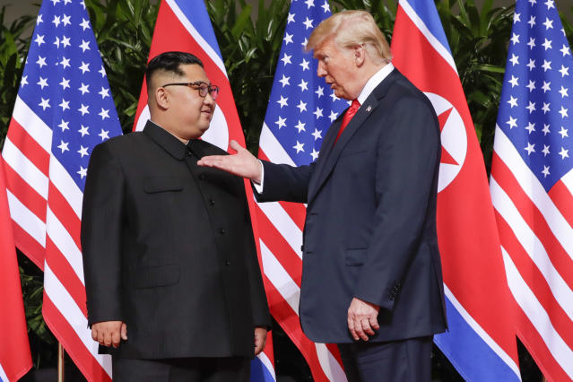 <p>President Donald Trump gestures toward the meeting site with North Korea leader Kim Jong Un at the Capella resort on Sentosa Island Tuesday, June 12, 2018 in Singapore. (Photo: Evan Vucci/AP) </p>