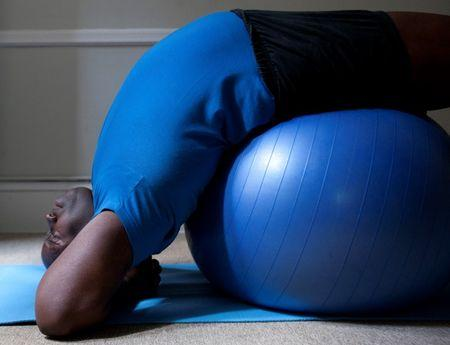 Yoga instructor Michael Hayes, owner of Buddha Body Yoga, warms up before teaching a class