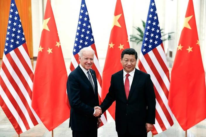 Chinese President Xi Jinping shakes hands with the then US vice president, Joe Biden, in Beijing in 2013