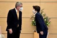 FILE PHOTO: Japan's Minister for the Tokyo Olympic and Paralympic Games Seiko Hashimoto greets International Olympic Committee (IOC) president Thomas Bach during a meeting in Tokyo on November 16, 2020.