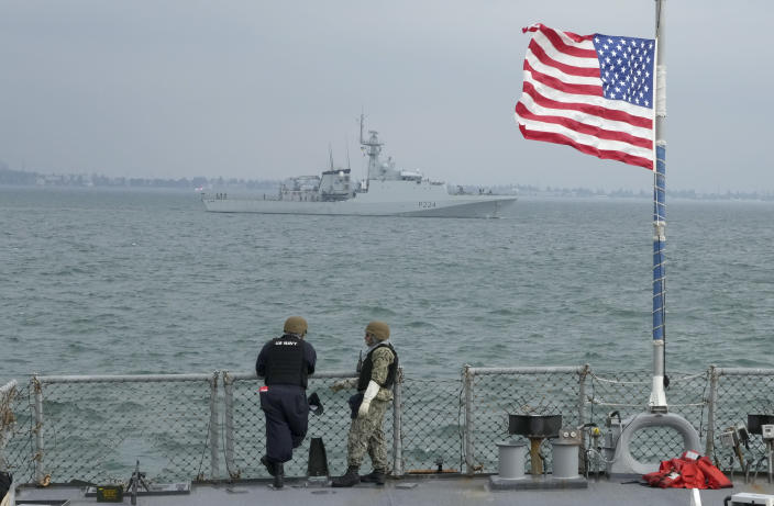 """Members of the U.S. Navy of the Arleigh Burke-class guided-missile destroyer USS Ross look on Britain's Royal Navy patrol ship OPV """"Trent"""" in Sea Breeze 2021 maneuvers in the Black Sea, Wednesday, July 7, 2021. Ukraine and NATO have conducted Black Sea drills involving dozens of warships in a two-week show of their strong defense ties and capability following a confrontation between Russia's military forces and a British destroyer off Crimea last month. (AP Photo/Efrem Lukatsky)"""
