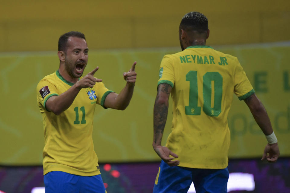 Brazil's Everton Ribeiro (L) celebrates with Brazil's Neymar after scoring against Peru during the South American qualification football match for the FIFA World Cup Qatar 2022 at the Pernambuco Arena in Recife, Brazil, on September 9, 2021. (Photo by NELSON ALMEIDA / AFP) (Photo by NELSON ALMEIDA/AFP via Getty Images)