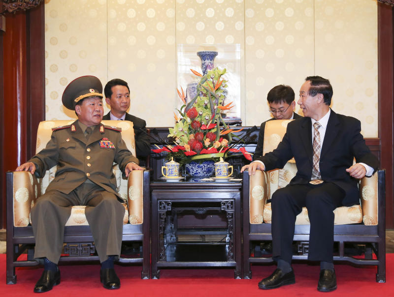 In this photo provided by China's official Xinhua News Agency, Wang Jiarui, right, the head of the Chinese leadership's international affairs office, meets with North Korea's Vice Marshal Choe Ryong Hae, a senior Workers' Party official and the military's top political officer, left,  in Beijing, Wednesday, May 22, 2013. North Korean leader Kim Jong Un veered from threats of nuclear war to tentative diplomacy by sending a trusted confidant to China on Wednesday, a high-profile outreach to Beijing's new leadership at a time of strained ties between the allies. (AP Photo/Xinhua, Ding Lin) NO SALES