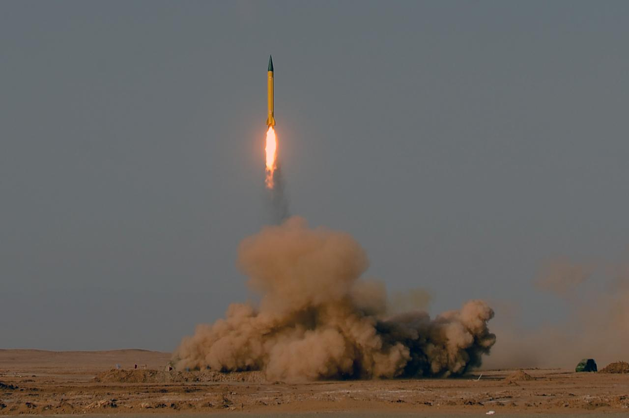 In this photo provided by the Iranian Students News Agency (ISNA), a surface-to-surface missile is launched during the Iranian Revolutionary Guards maneuver in an undisclosed location in Iran, Tuesday, July 3, 2012. Iran's powerful Revolutionary Guards test fired several ballistic missiles on Tuesday, including a long-range variety capable of hitting U.S. bases in the region as well as Israel, Iranian media reported. (AP Photo/ISNA, Alireza Sot Akbar)