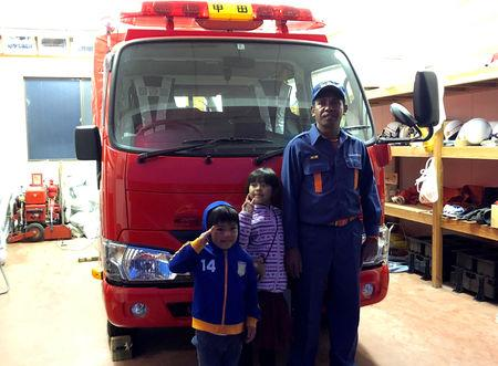 East Timorese Leonel Maia, 33, poses for a photograph with his children at a fire station where he volunteers as a firefighter in Akitakata, Hiroshima prefecture, western Japan November 26, 2018. Picture taken November 26, 2018.  REUTERS/Ami Miyazaki