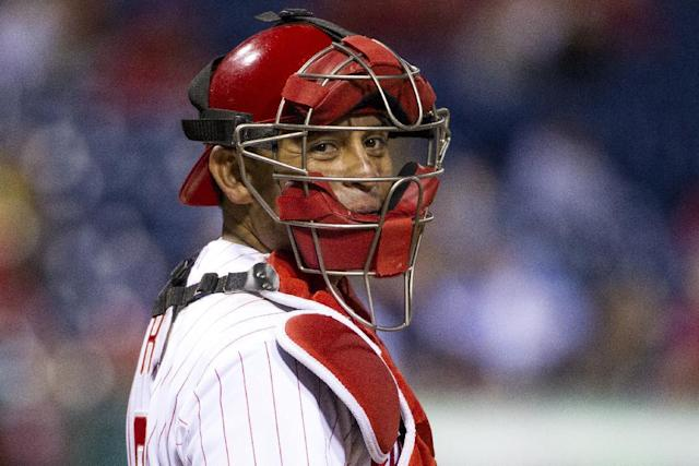 FILE - In a Monday, Sept. 16, 2013 file photo, Philadelphia Phillies catcher Carlos Ruiz looks back to the dugout against the Miami Marlins during the ninth inning of a baseball game, in Philadelphia. Two people familiar with the negotiations tell the Associated Press Monday, Nov. 18, 2013 that Ruiz and the Phillies have agreed to a $26 million, three-year contract that will keep the former All-Star catcher in Philadelphia. (AP Photo/Chris Szagola, File)