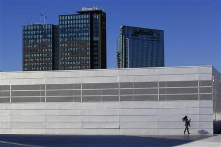 A woman carries her child on the roof of the Opera House in Oslo in this June 20, 2012 file photo. REUTERS/Cathal McNaughton/Files
