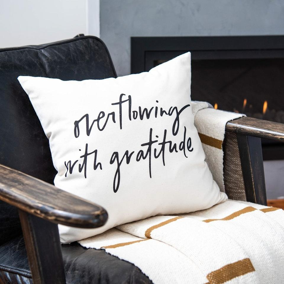 """<p>If you're not overflowing with gratitude now, the <a href=""""https://www.popsugar.com/buy/Overflowing-Gratitude-Pillow-488094?p_name=Overflowing%20With%20Gratitude%20Pillow&retailer=shop.magnolia.com&pid=488094&price=35&evar1=casa%3Aus&evar9=46582456&evar98=https%3A%2F%2Fwww.popsugar.com%2Fhome%2Fphoto-gallery%2F46582456%2Fimage%2F46582524%2FOverflowing-With-Gratitude-Pillow&list1=shopping%2Cdecor%20shopping%2C50%20under%20%2450%2Cjoanna%20gaines%2Chome%20shopping%2Cmagnolia%20home&prop13=api&pdata=1"""" rel=""""nofollow"""" data-shoppable-link=""""1"""" target=""""_blank"""" class=""""ga-track"""" data-ga-category=""""Related"""" data-ga-label=""""https://shop.magnolia.com/collections/pillows-and-throws/products/overflowing-with-gratitude-pillow"""" data-ga-action=""""In-Line Links"""">Overflowing With Gratitude Pillow</a> ($35) will surely get you in the mood to be.</p>"""
