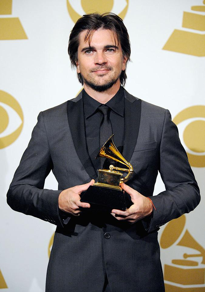 Juanes poses in the press room during the 55th Annual GRAMMY Awards at STAPLES Center on February 10, 2013 in Los Angeles, California.