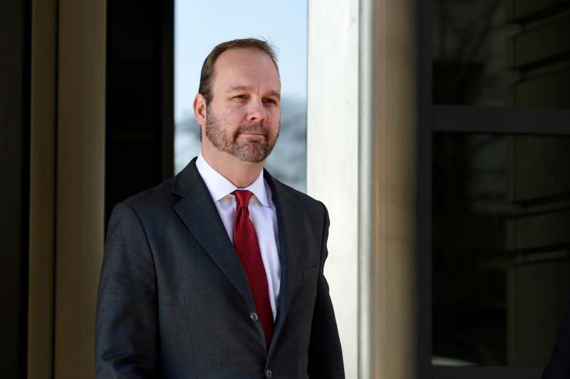 FILE - In this Dec. 11, 2017, file photo, Rick Gates, center, departs federal court in Washington. Robert Mueller's Russia investigation is illustrating an age-old truism: It pays to cooperate with the government. The few people who so have cooperated with the special counsel's office have enjoyed perks including the prospect of reduced prison sentences. Gates, for weeks on home confinement with electronic monitoring, gets rapid approval for a family vacation and shaves down his potential prison time. (AP Photo/Susan Walsh, File)