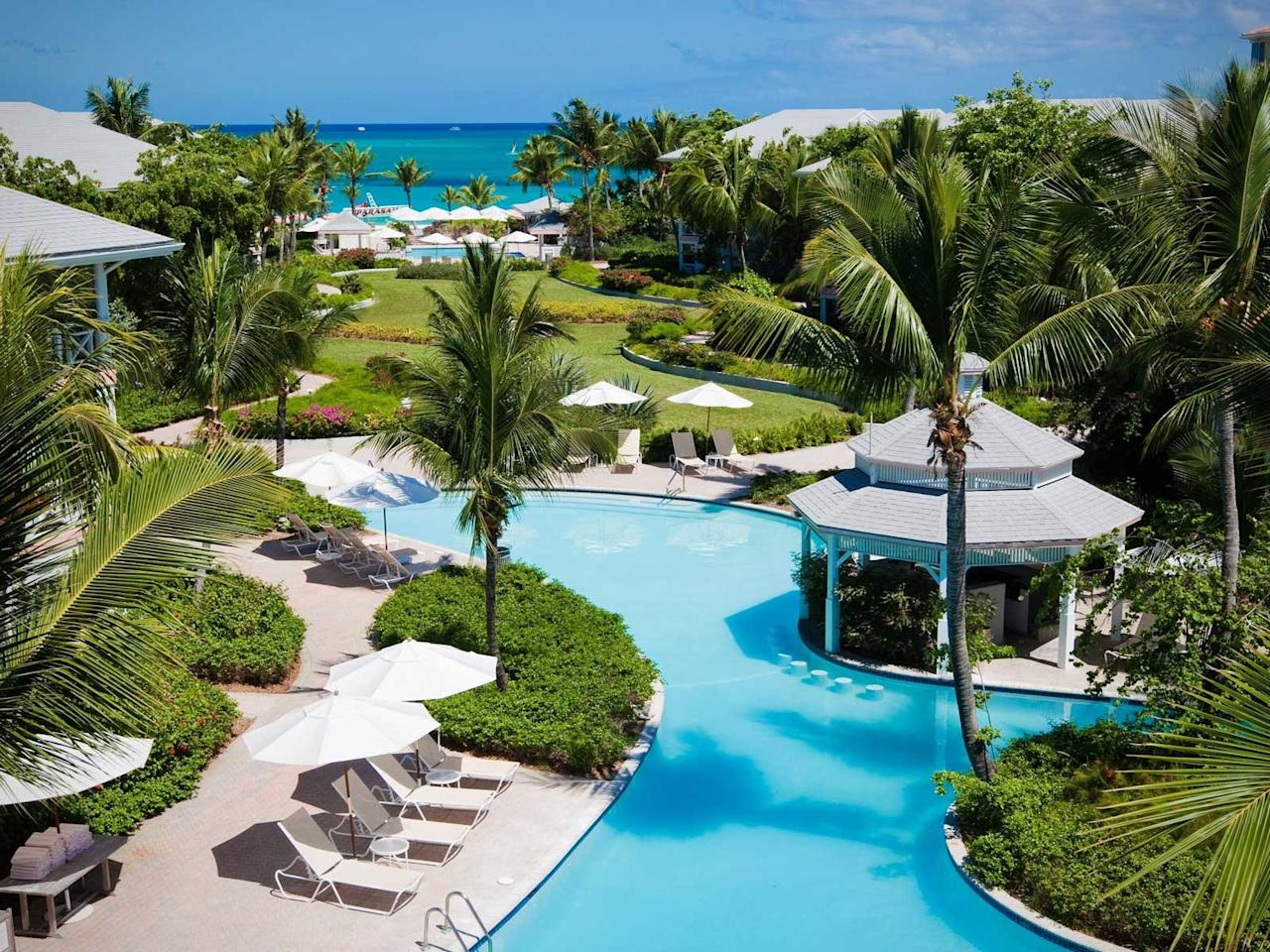 """<p>If you and your special someone are looking for a quick escape, this is the place to do it. With their <a href=""""https://www.oceanclubresorts.com/specialty-packages/dining-package/"""">3 Days, 3 Choices package</a> you'll get nine meal vouchers — three for breakfast, three for lunch, and three for dinner — so you can decide where you want to go and what you want to order during your vacation.</p> <p>This resort is next to Grace Bay Beach in Providenciales, <a href=""""https://www.travelandleisure.com/travel-guide/turks-caicos"""">Turks and Caicos</a> and has suites with kitchens, washer/dryers, and porches. On-site you can do watersports, bike, play a game of tennis, and enjoy the beach.</p>"""