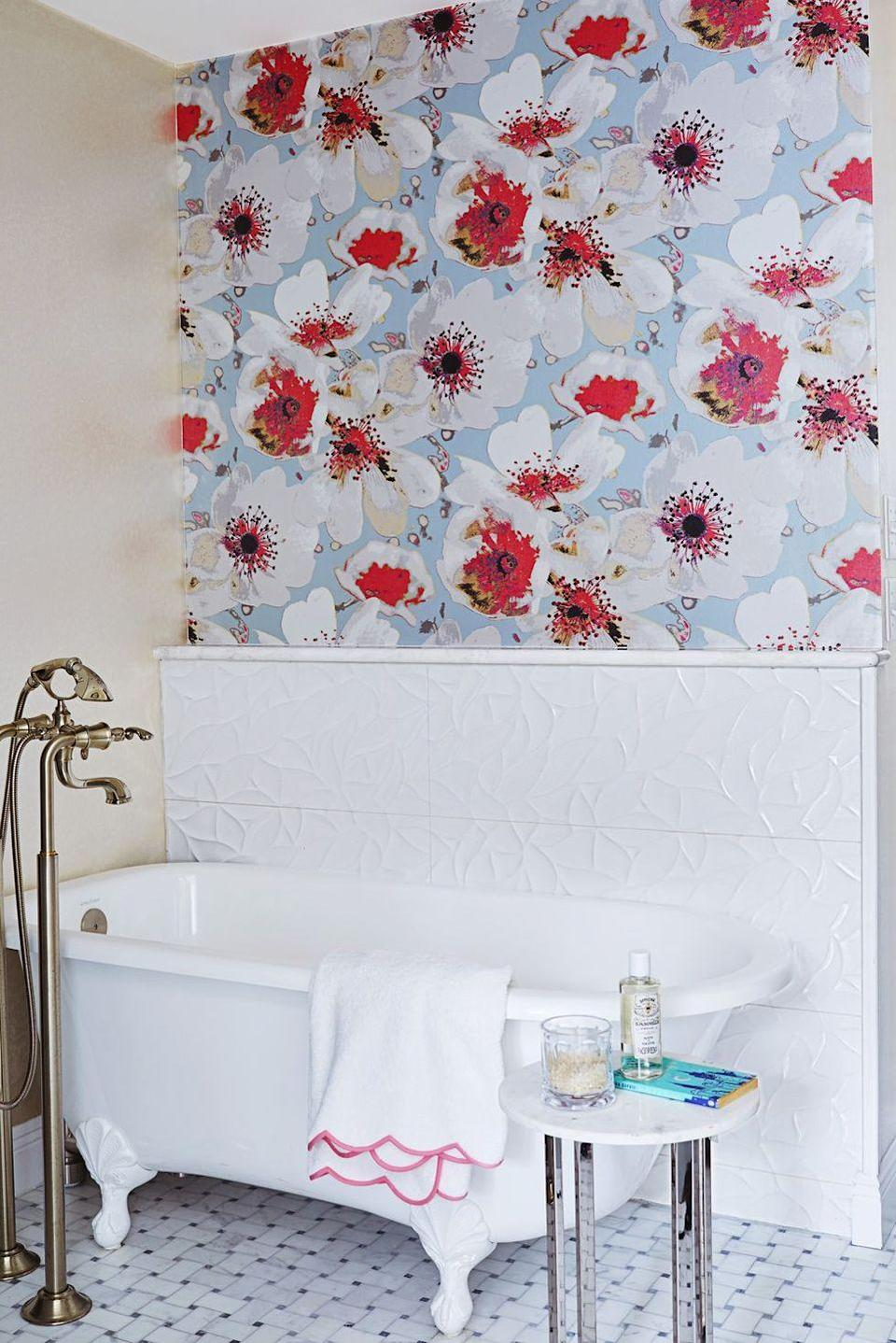 <p>If there's one room that can benefit from a dose of drama, it's the bathroom. A wallpaper boasting bold blooms is a no-fail option for a quick refresh.</p>