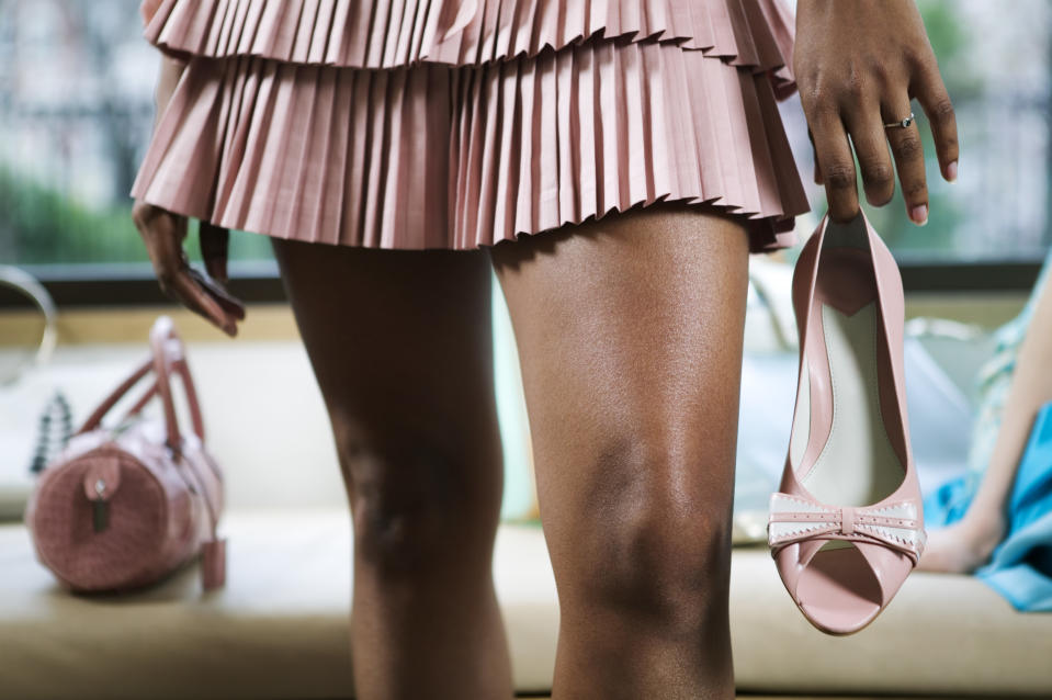 Woman in miniskirt with shoe