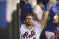 New York Mets' Jeff McNeil celebrates in the dugout after hitting a home run during the seventh inning of a baseball game against the Philadelphia Phillies, Sunday, Sept. 19, 2021, in New York. (AP Photo/Jason DeCrow)