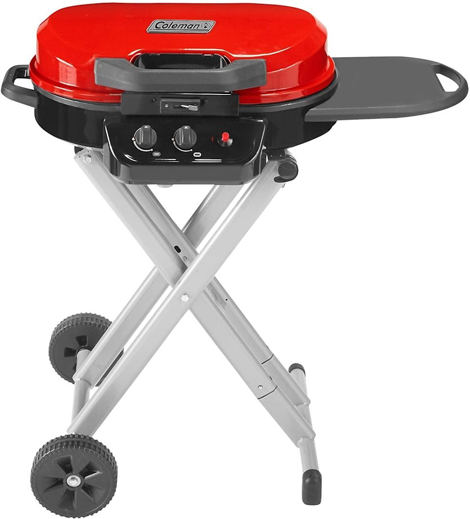 <p>The <span>Coleman Gas Grill   Portable Propane Grill   RoadTrip 225 Standup Grill, Red</span> ($220) has two adjustable burners and a push-ignition for matchless lighting. It's easy to transport since the legs and wheels fold into the grill and can easily fit inside trunks. You can even change the cast iron grates with griddles or stove grates.</p>