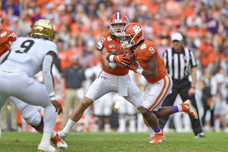 Clemson quarterback Trevor Lawrence hands the ball off to Travis Etienne during the first half of an NCAA college football game against Wake Forest on Nov. 16, 2019. (AP)
