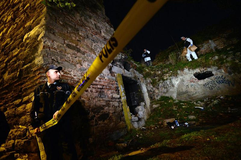 FILE - This Feb. 2, 2013 file photo shows police forensics workers searching for Sarai Sierra, a missing New York City woman, near the remnants of some ancient city walls in low-income district of Sarayburnu in Istanbul, Turkey. Sierra, a 33-year-old mother of two, went missing while vacationing alone in Istanbul. Her body was discovered Feb. 2 amid the city walls. Recent high-profile attacks on tourists in India, Brazil, Turkey and Mexico have raised questions about personal safety for overseas travel, especially for women. But frequent travelers and those who work in the industry say a few common-sense precautions can go a long way to ensuring personal safety. (AP Photo, file)
