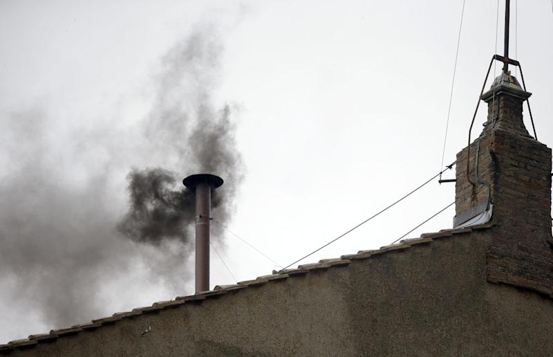 Black smoke emerges from the chimney on the roof of the Sistine Chapel, in St. Peter's Square at the Vatican, Wednesday, March 13, 2013. The black smoke indicates that the new pope has not been elected yet. (AP Photo/Gregorio Borgia)