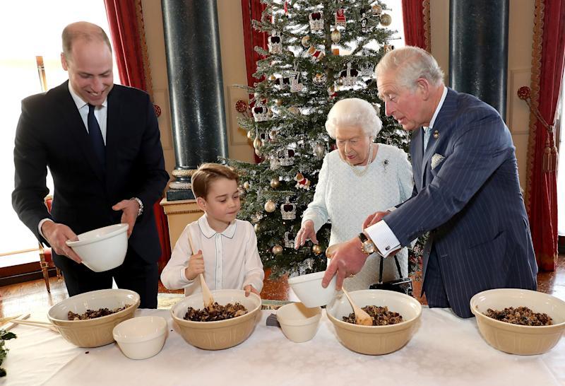 Prince William, Prince George, Queen Elizabeth, and Prince Charles working on their Christmas puddings