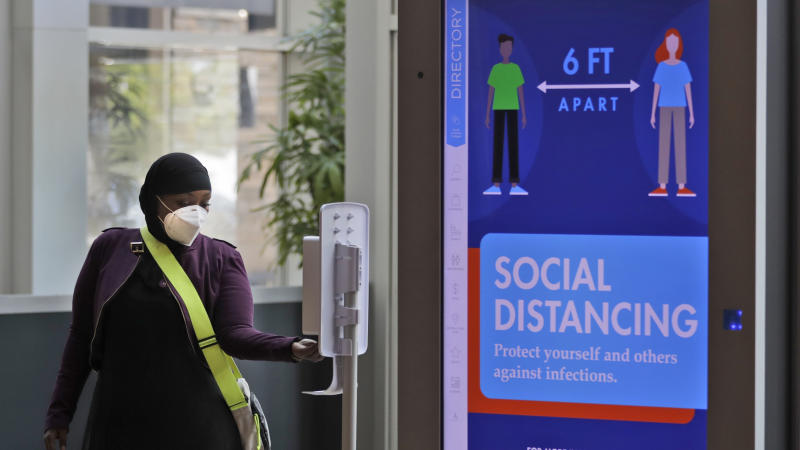 A woman dispenses hand sanitizing lotion at SouthPark Mall, Wednesday, May 13, 2020, in Strongsville, Ohio. Ohio retail businesses reopened Tuesday following a nearly two-month-long shutdown ordered by Gov. Mike DeWine to limit the spread of the coronavirus. (AP Photo/Tony Dejak)