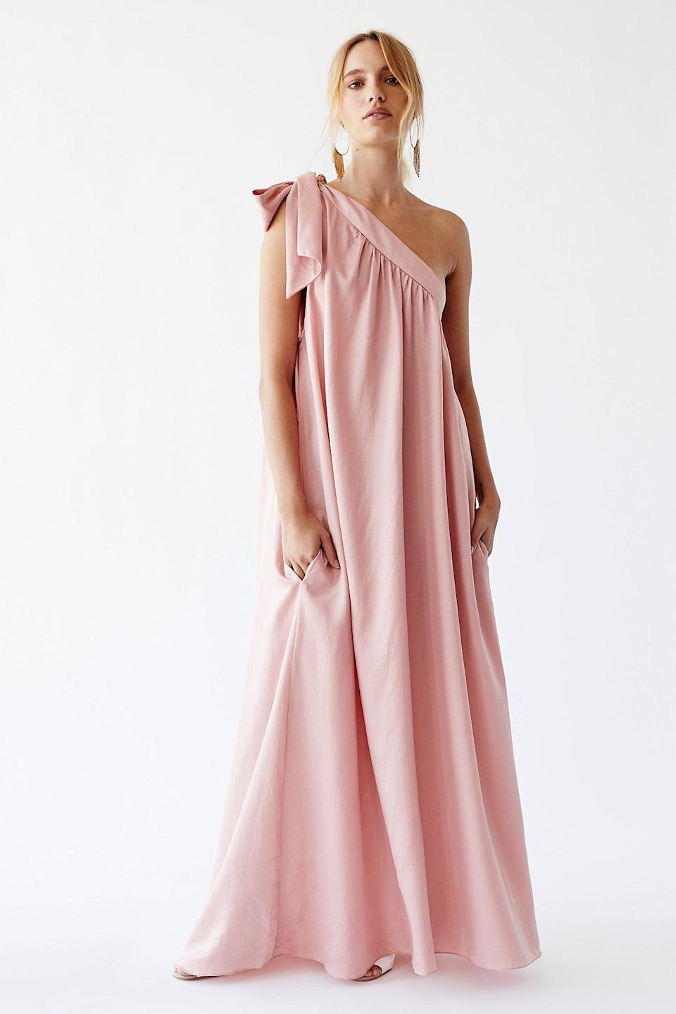 """<h2>Free People Soa Dress In Light Pink</h2><br>Single-shoulder frocks seem to be everywhere right now — frequently occurring in the type of free-flowing, floor-skimming silhouette that we've grown very accustomed to during quarantine. With a silky fabrication (made from eco-friendly cupro, a cotton byproduct) and a cheeky oversized bow, this light pink dress is perfect for your carefree nuptials. <br><br><em>Shop <strong><a href=""""http://freepeople.com"""" rel=""""nofollow noopener"""" target=""""_blank"""" data-ylk=""""slk:Free People"""" class=""""link rapid-noclick-resp"""">Free People</a></strong></em><br><br><strong>Free People</strong> Soa Dress, $, available at <a href=""""https://go.skimresources.com/?id=30283X879131&url=https%3A%2F%2Fwww.freepeople.com%2Fshop%2Fsoa-dress%2F%3Fcategory%3Dmaxi-dresses%26color%3D066%26type%3DREGULAR%26quantity%3D1"""" rel=""""nofollow noopener"""" target=""""_blank"""" data-ylk=""""slk:Free People"""" class=""""link rapid-noclick-resp"""">Free People</a>"""