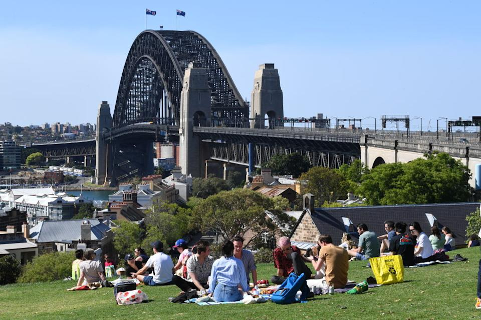 People gather for picnics at Observatory Hill in Sydney, Australia.