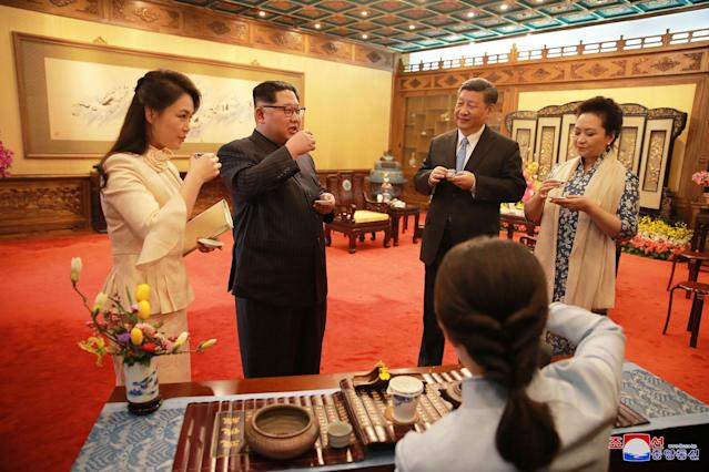 <p>In an undated photo released March 28 2018 by the North Korean Central News Agency (KCNA), North Korean leader Kim Jong-un (C-L) and his wife Ri Sol-ju (L) meeting with Chinese President Xi Jinping (C-R) and his wife Peng Liyuan as they visit the Diaoyutai State Guesthouse in Beijing, China. (Photo: KCNA/EPA-EFE/REX/Shutterstock) </p>