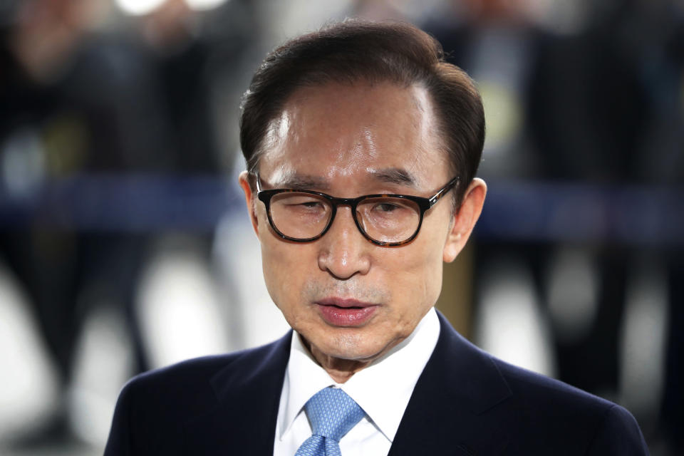 FILE - In this March 14, 2018, file photo, former South Korean President Lee Myung-bak arrives for questioning over bribery allegations at the Seoul Central District Prosecutors' Office in Seoul, South Korea. South Korea's top court on Thursday, Oct. 29, 2020, upheld a 17-year prison term imposed on ex-President Lee over a range of high-profile corruption charges, a ruling that will send him back to jail again.(Kim Hong-Ji/Pool Photo via AP, File)