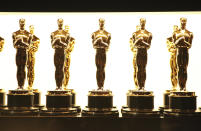 FILE - In this Feb. 26, 2017 file photo, Oscar statuettes appear backstage at the Oscars in Los Angeles. Some people watch awards shows out of love, others because they love to hate. But this year, as ratings have taken a dive, will anybody tune in to the Oscars? Pushed by the pandemic from its usual berth of February or early March, the Academy Awards will be presented April 25 on ABC. (Photo by Matt Sayles/Invision/AP, File)