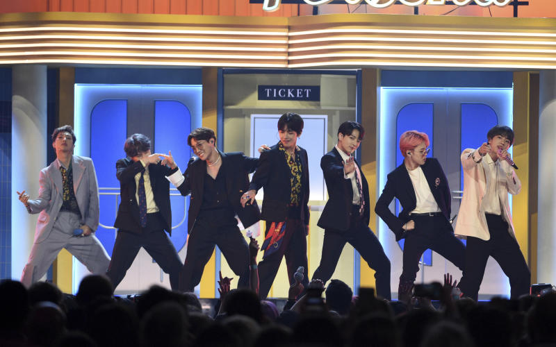 """FILE - This May 1, 2019 file photo shows BTS performing """"Boy With Luv"""" at the Billboard Music Awards in Las Vegas. The Korean pop band is set to perform on the iHeartRadio Jingle Ball Tour this holiday season. IHeartMedia announced Friday, Sept. 27, 2019, that the 12-city tour kicks off Dec. 1 in Tampa Bay, Florida. (Photo by Chris Pizzello/Invision/AP, File)"""