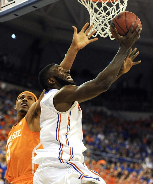 Florida center Patric Young (4) shoots asTennessee forward Jarnell Stokes (5) defends during the first half of an NCAA college basketball game Saturday, Jan. 25, 2014, in Gainesville, Fla. (AP Photo/Phil Sandlin)