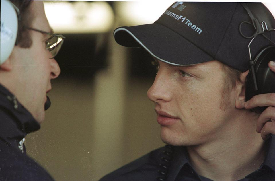 New Williams driver Jenson Button chats to a race engineer during testing