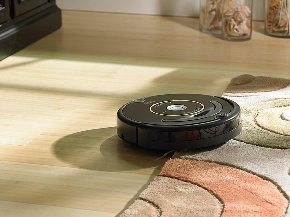 <p>A vacuum cleaner that cleans the house without help? Sign us up! The <span>iRobot Roomba 650 Robot Vacuum</span> ($225) will definitely cut down cleaning time, with a side bonus: it'll be good for their back because they won't have to bend to vacuum those hard-to-reach spots. </p>