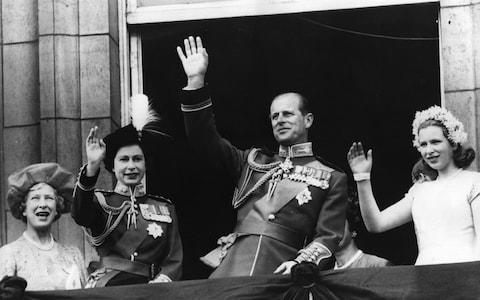 Queen Elizabeth, Prince Philip and Princess Anne wave to crowds from the balcony of Buckingham Palace after a Trooping the Colour ceremony in 1963 - Credit: Keystone
