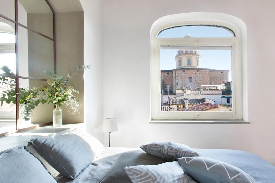 """What a view: This three-bedroom Airbnb offers an unparalleled look at <a href=""""https://www.cntraveler.com/destinations/florence?mbid=synd_yahoo_rss"""" rel=""""nofollow noopener"""" target=""""_blank"""" data-ylk=""""slk:Florence's"""" class=""""link rapid-noclick-resp"""">Florence's</a> San Frediano in Cestello church. In fact, the building itself was a former Carmelite monastery in the 15th century—this particular apartment is on the third floor, so pray for strength on the steps. (One of the bedrooms is also in the loft, so prep for more steps.) There's air conditioning, a washer/dryer, and a decent-sized kitchen inside. Outside, you're just a 10-minute walk from <a href=""""https://www.cntraveler.com/activities/florence/palazzo-pitti?mbid=synd_yahoo_rss"""" rel=""""nofollow noopener"""" target=""""_blank"""" data-ylk=""""slk:Palazzo Pitti"""" class=""""link rapid-noclick-resp"""">Palazzo Pitti</a> and 15 minutes from the <a href=""""https://www.cntraveler.com/activities/florence/the-uffizi-gallery?mbid=synd_yahoo_rss"""" rel=""""nofollow noopener"""" target=""""_blank"""" data-ylk=""""slk:Uffizi Gallery"""" class=""""link rapid-noclick-resp"""">Uffizi Gallery</a>. $259, Airbnb (Starting Price). <a href=""""https://www.airbnb.com/rooms/18080516"""" rel=""""nofollow noopener"""" target=""""_blank"""" data-ylk=""""slk:Get it now!"""" class=""""link rapid-noclick-resp"""">Get it now!</a>"""