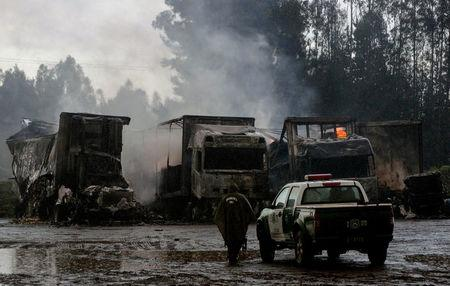 Burnt-out trucks are pictured in Temuco city
