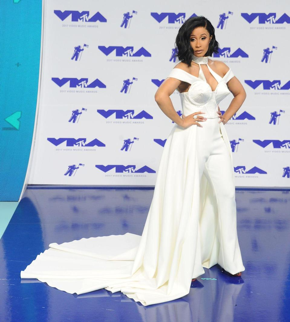 """<p>After a breakout year with the release of """"Bodak Yellow,"""" Cardi B wowed in this white jumpsuit with a cone-bra detail.</p>"""