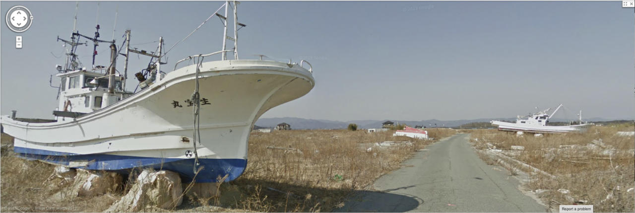 In this screenshot made from the Google Maps website provided Wednesday, March 27, 2013, by Google, showing stranded ships left as a testament to the power of the tsunami which hit the area, near a road in March, 2013, in Namie, Japan, a nuclear no-go zone where former residents have been unable to live since they fled from radioactive contamination from the Fukushima Dai-ichi nuclear power plant two years ago. Google Street View is giving the world a rare glimpse into Japan's eerie ghost town, following the March 2011 earthquake and tsunami which sparked a nuclear disaster that has left the area uninhabitable. The photo technology pieces together digital images captured by Google's camera-equipped vehicle and allows viewers to take virtual tours of locations around the world. (AP Photo/Google) EDITORIAL USE ONLY