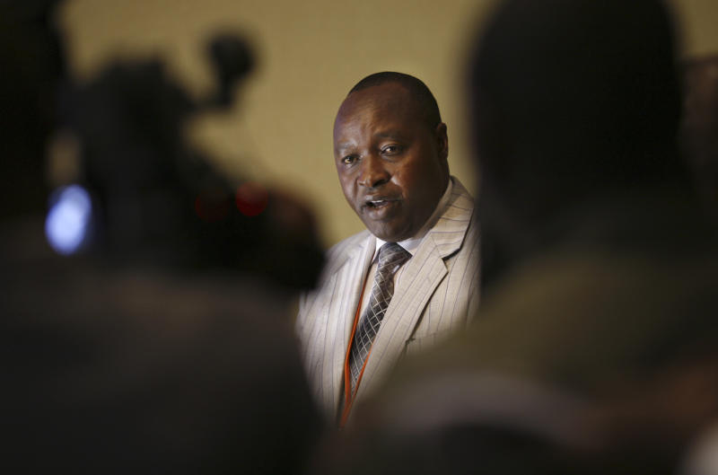 In this photo taken Sunday, Dec. 9, 2012, Francois Rucogoza, leader of the delegation of Congolese M23 rebels, speaks at the opening of peace talks with a delegation from the Congolese government in Kampala, Uganda. Representatives of rebels attending peace talks with the Congolese government dodged a crucial meeting Monday at which the government delegation was to respond to earlier criticism, a development that could jeopardize negotiations to end the crisis in eastern Congo. (AP Photo/Rebecca Vassie)