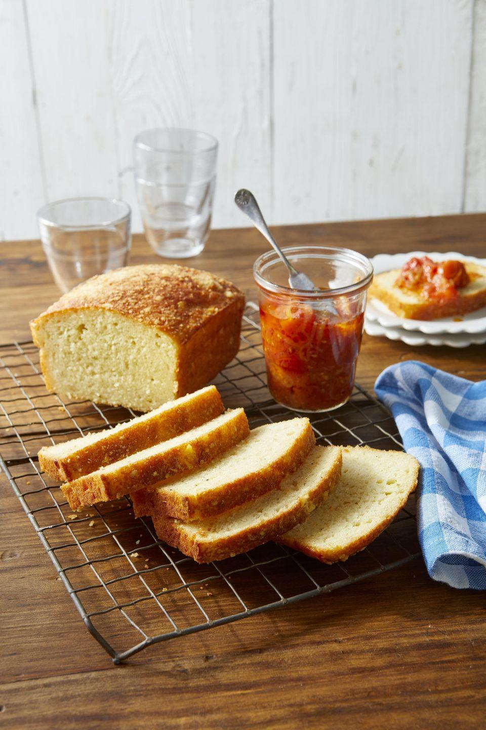 """<p>For an extra treat, try this savory bread topped with a bit of spicy <a href=""""https://www.countryliving.com/food-drinks/recipes/a1652/tomato-jam-3768/"""" rel=""""nofollow noopener"""" target=""""_blank"""" data-ylk=""""slk:tomato jam"""" class=""""link rapid-noclick-resp"""">tomato jam</a>.</p><p><strong><a href=""""https://www.countryliving.com/food-drinks/a34946658/parmesan-and-garlic-quick-bread-recipe/"""" rel=""""nofollow noopener"""" target=""""_blank"""" data-ylk=""""slk:Get the recipe"""" class=""""link rapid-noclick-resp"""">Get the recipe</a>.</strong></p><p><a class=""""link rapid-noclick-resp"""" href=""""https://www.amazon.com/USA-Pan-1140LF-Bakeware-Aluminized/dp/B0029JQEIC/?tag=syn-yahoo-20&ascsubtag=%5Bartid%7C10050.g.35246097%5Bsrc%7Cyahoo-us"""" rel=""""nofollow noopener"""" target=""""_blank"""" data-ylk=""""slk:SHOP LOAF PANS"""">SHOP LOAF PANS</a><br></p>"""