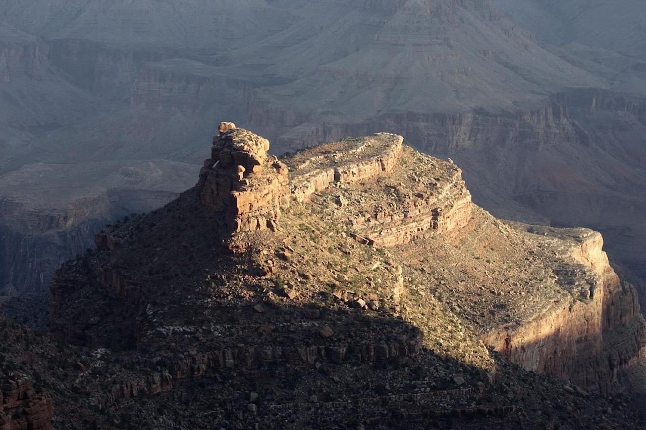 This Monday Oct. 22, 2012, photo shows a view from the South Rim of the Grand Canyon National Park in Arizona. Search engine giant Google is using the Trekker, a nearly 40-pound, backpack-sized camera unit, to showcase the Grand Canyon's most popular hiking trails on the South Rim and other off-road sites. It's the latest evolution in mapping technology for the Mountain View, Calif., company, which has used a rosette of cameras to photograph thousands of cities and towns in dozens of countries for its Street View feature. (AP Photo/Rick Bowmer)